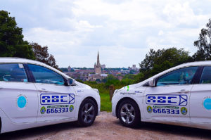 ABC branded taxis with Norwich skyline background