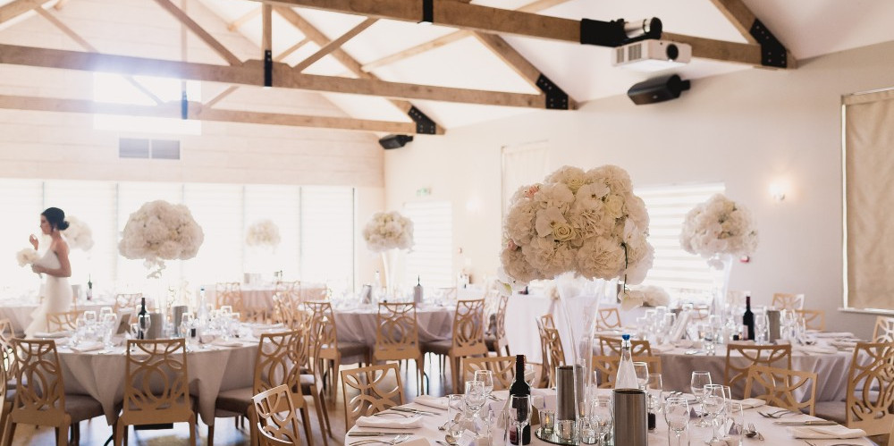 The Breakfast Room wedding reception dining area at The Boathouse, Ormesby