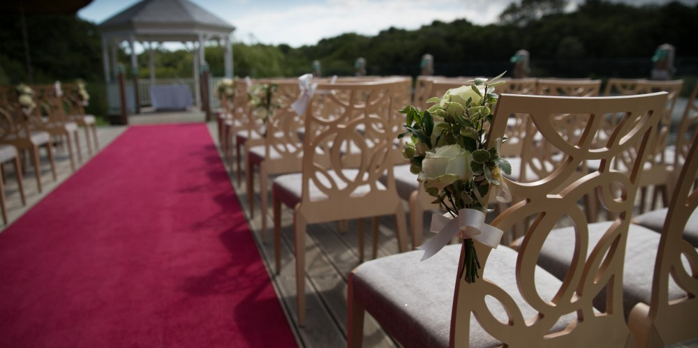 wedding ceremony chairs on wooden deck at Ormesby Broad, Norfolk